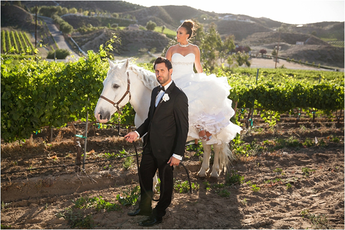 Black Desire tuxedo, Michael kors tuxedo, slim fit, gershon bachus vintners, Temecula wedding, Michelle Garibay events, if you are thinking about a destination wedding, wine country, gold wedding, boutique feel, luxury, luxurious, lavish, elegant, regal, Jaime elyse couture, bride sitting on horse with groom
