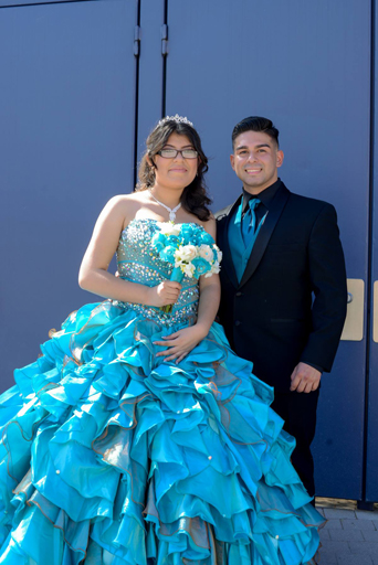 Quinceanera, quince, Chambelan, chambelanes, quince girl, 15th birthday, Quinceanera.com, black Monterey tuxedo, classic black tuxedo, tuxedo with notch lapel chambelan outfit, chambelanes outfit, black Lorenzo tuxedo, tuxedo with shawl lapel, what to dress your chambelanes in, black desire tuxedo, Michael kors tuxedo, white Casablanca dinner jacket, Spanish culture, Spanish tradition, birthday celebration, blue quince girl
