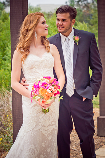 Green Acre San Diego Wedding Bride Wearing a Lace Bridal Gown and Groom is Wearing a Black Valencia Suit, San Diego Wedding, organic wedding catering, equinox photo, Green Acre wedding style, friar tux shop