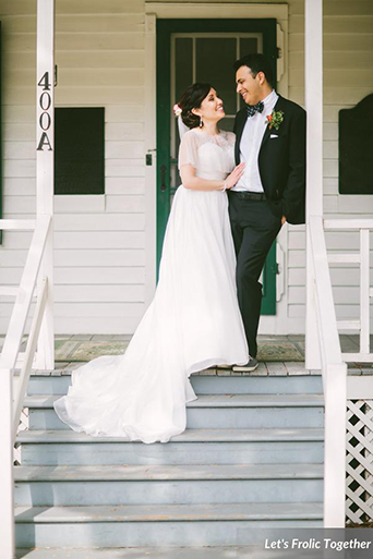 Casa Bella Event Center Outdoor Wedding with the Groom wearing a Black Suit, wedding photo on steps