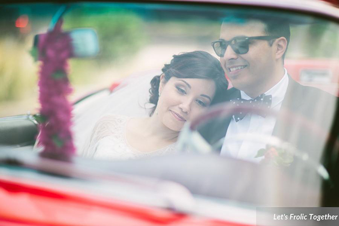 Casa Bella Event Center Vintage Red Car with the Bride and Groom, vintage red convertible wedding photo