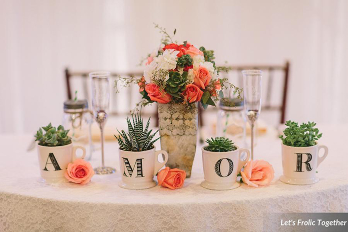 Casa Bella Event Center Wedding Amor Table Decor, coral roses and succulents for wedding flowers