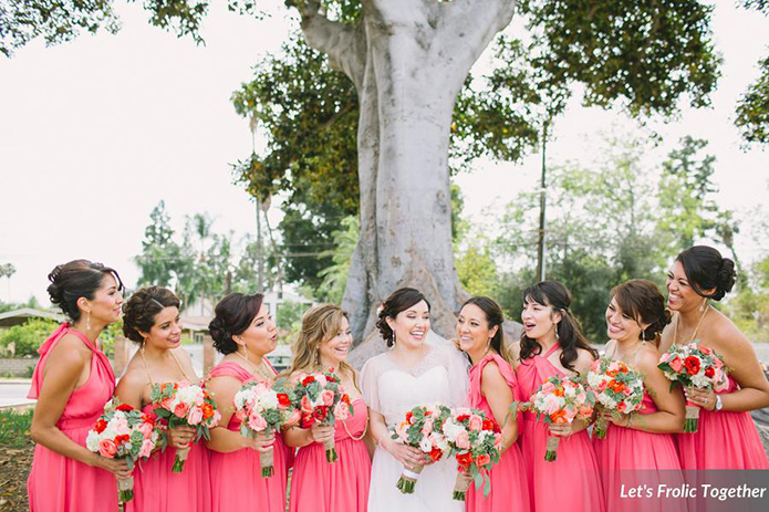 Casa Bella Event Center Wedding Bride with Bridesmaids Wearing Pink, mixed coral bridesmaid gowns, mixed pink bridesmaid dresses