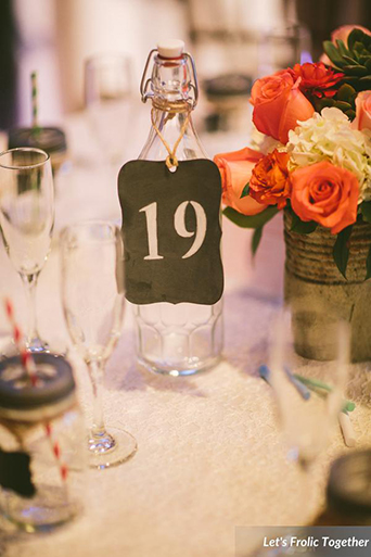 Casa Bella Event Center Wedding Centerpiece Table Number, rustic table numbers on bottles with metal