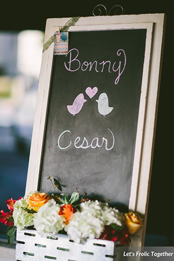 Casa Bella Event Center Wedding Ceremony Chalkboard Signage with flowers
