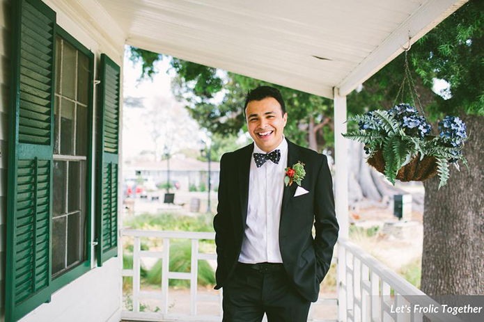 Casa Bella Event Center Wedding Groom Wearing Black Suit with Polka Dot Bow Tie and White Pocketsquare
