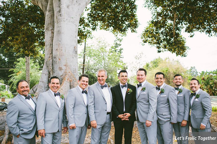 Casa Bella Event Center Wedding Groom is wearing a Black Suit and Groomsmen wearing Grey Suits, groom in black, groomsmen in grey