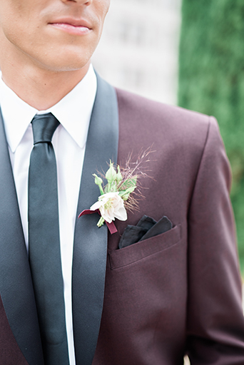 Westgate Hotel Wedding with the Groom in a Burgundy Tuxedo with a Black Shawl Lapel, Westgate hotel wedding, san diego wedding, southern California wedding, burgundy tuxedo with shawl lapel, hues of burgundy, burgundy wedding, berry and burgundy, royal wedding, vintage wedding, royal vintage wedding, ornate gold details, fancy wedding, glam wedding, fall wedding, winter wedding, layered vintage, elegant lace, elegant calligraphy, romantic wedding, romance wedding, rich red color palette, ornate details, groom's look, burgundy coat with black pants, stylish groom's look, burgundy tuxedo with black skinny tie, black pocketsquare, unique groom's boutonniere