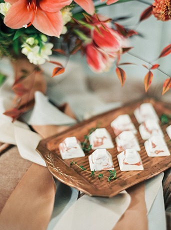 Downtown LA wedding at the honeypot rose gold inspired shoot pink and white floral decor with rose gold wedding decorations and brown wood platter with white linen and pink and white flowers wedding photo ideas