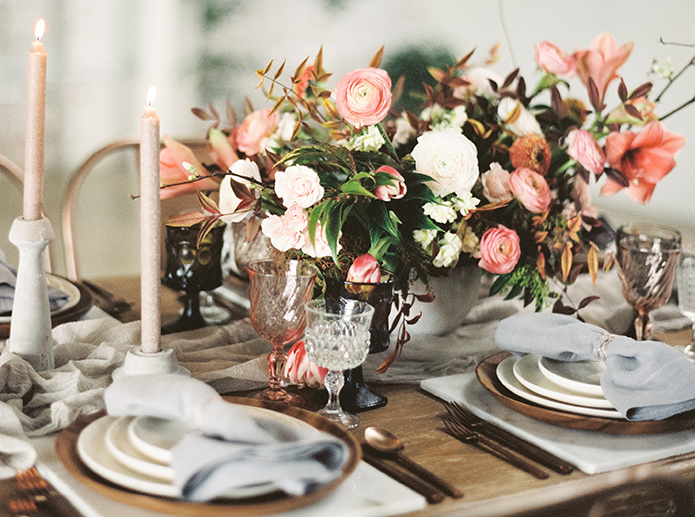 Downtown LA wedding at the honeypot rose gold inspired shoot full table set up brown wood table with rose gold metallic chairs and with white and pink flower centerpiece with candle decor and white place settings with hanging greenery decor wedding photo ideas
