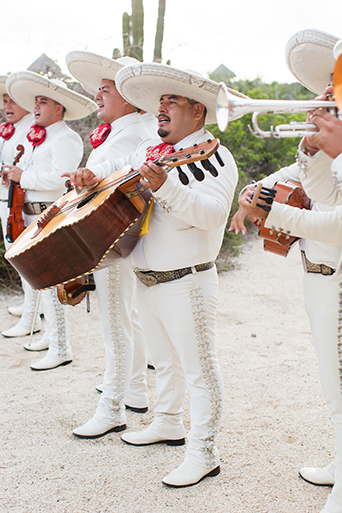 San Miguel beach wedding photo shoot musicians wearing all white with sombreros and red accent scarves playing guitar and different instruments wedding band photo idea