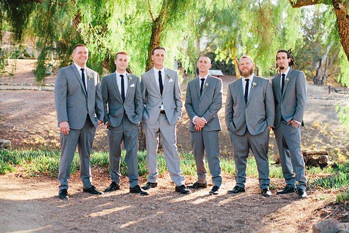 Rustic Leo carillo ranch wedding groom heather grey suit with white dress shirt and long black skinny tie with groomsmen charcoal grey suits with and white dress shirts with long black skinny ties