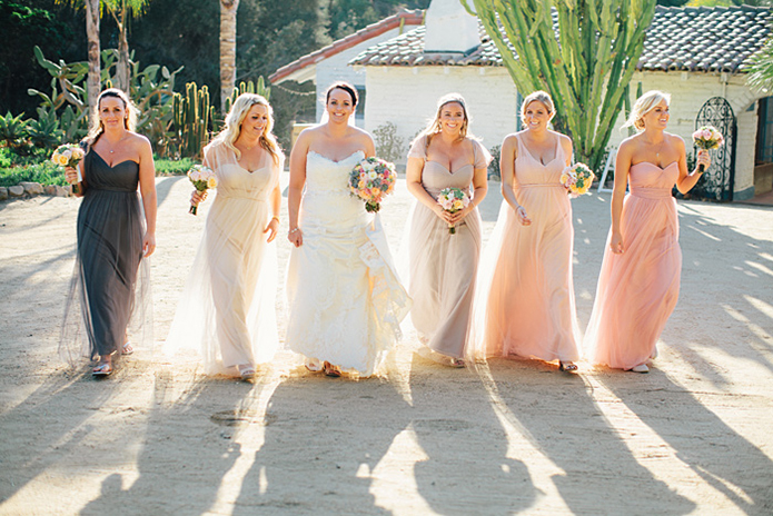 Rustic Leo carillo ranch wedding bride strapless lace gown with long lace detail veil with white and pink succulent and floral bridal bouquet with bridesmaids mix matched dresses pink and grey walking