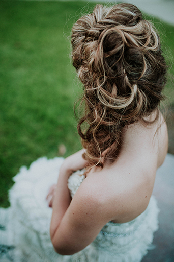 Jewel toned styled wedding shoot at the christmas house bride strapless lace and ruffled gown with crystal beading on top and wavy hair pulled to the side back of dress