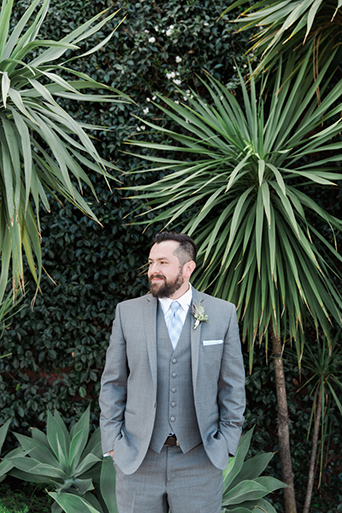 Los angeles rustic wedding at smogshoppe groom grey suit with white dress shirt and matching vest with light blue long tie with white floral boutonniere