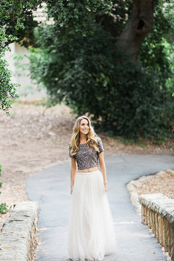 Santa barbara engagement shoot bride silver sequined crop top with long white tulle skirt and hair down with wavy design