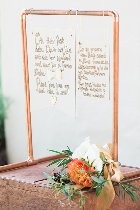 Chilean inspired outdoor wedding at quail ranch wedding reception decor crystal clear glass with copper border and writing with story of bride and groom and flower decor wedding photo idea