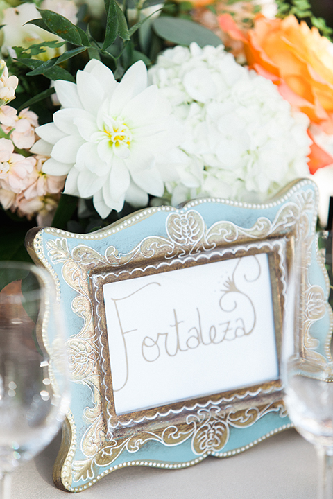 Chilean inspired outdoor wedding reception decor light blue vintage frame with white flower decor on table wedding photo idea for reception