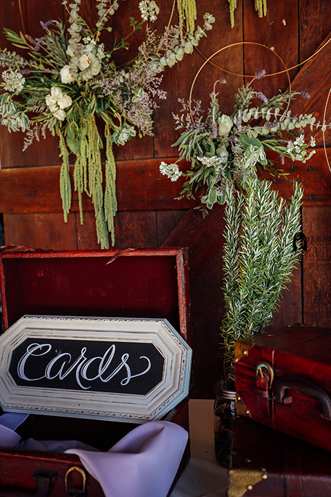 Big red barn styled wedding shoot black and white card box sign with hanging flower decor
