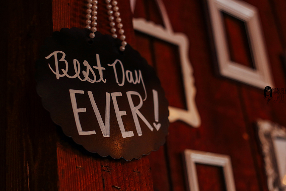 Big red barn styled wedding shoot black and white sign that says best day ever