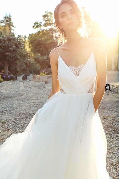 Big red barn styled wedding shoot bride tulle ball gown with lace detail on top and thin straps and hair updo