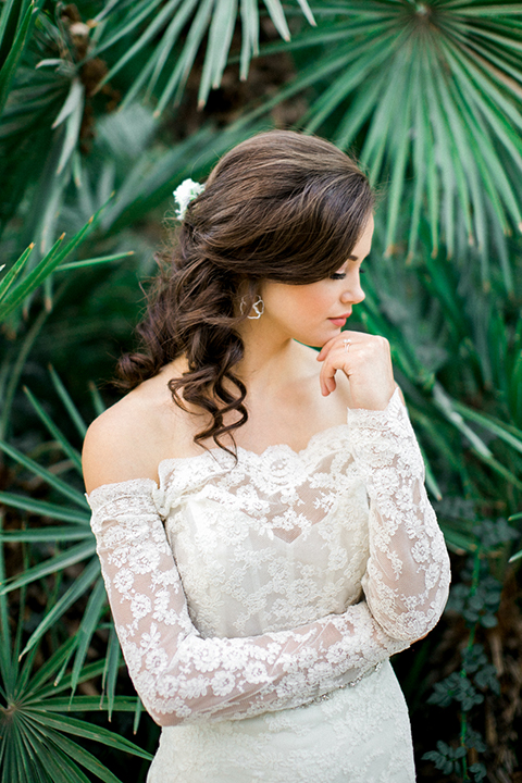 Rancho las lomas outdoor wedding shoot bride lace form fitting gown with off the shoulder long lace sleeves with white flower headpiece decor with rose gold wedding ring
