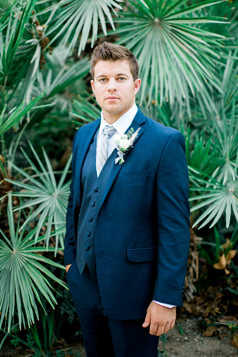 Rancho las lomas outdoor wedding shoot groom cobalt blue suit with matching vest and white dress shirt with light blue long striped tie and white floral boutonniere
