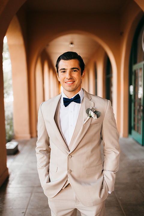 San diego big fake wedding shoot at brick groom tan suit with matching vest and white dress shirt with white floral boutonniere close up