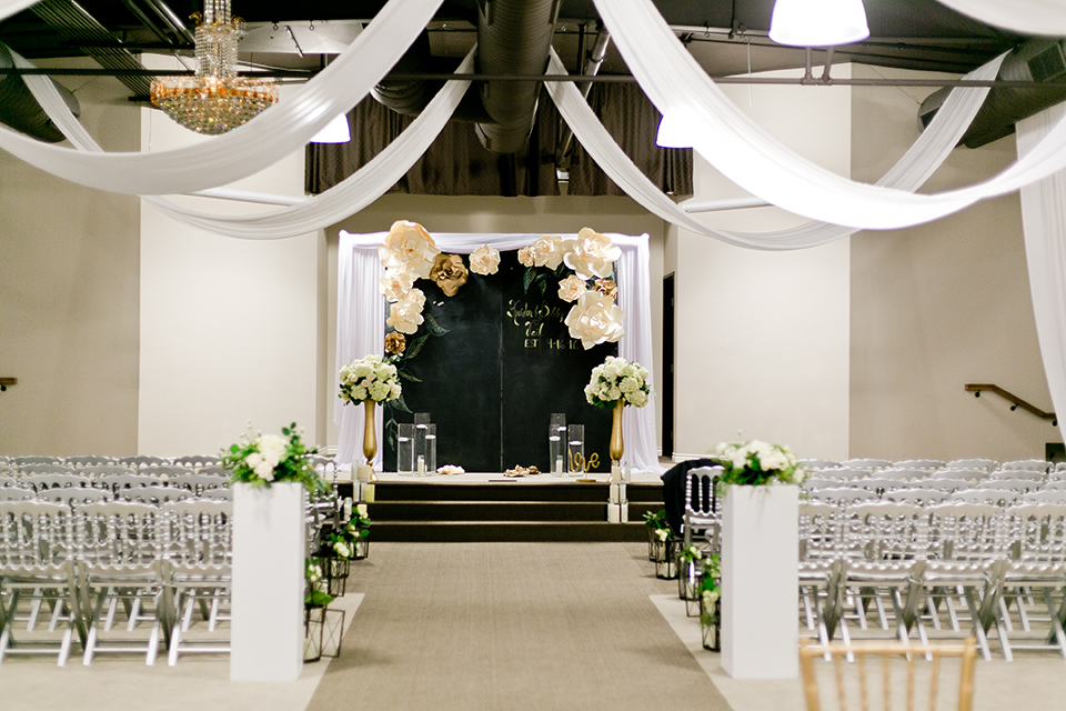 Upland wedding styled shoot ceremony set up with white hanging drapery and white flowers with clear chairs set up wedding photo idea for ceremony