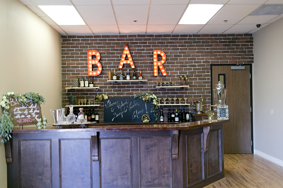 Upland wedding styled shoot bar set up with light up marquee letters and wine glasses and drinks behind bar wedding photo idea