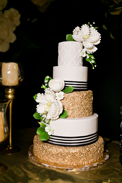 Upland wedding styled shoot five tier white and gold wedding cake with black striped design and white flower decor and gold candles