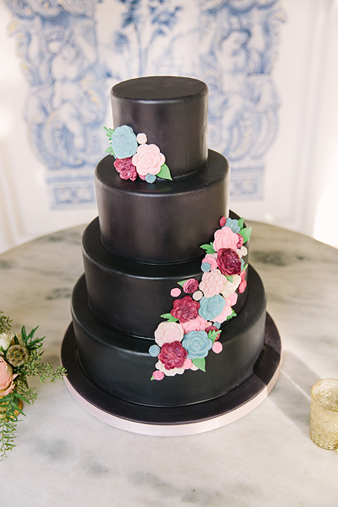 Orange county wedding shoot at rancho las lomas wedding cake four tier black wedding cake with pink and red flower decor on side on black cake stand with table and candle decor wedding photo idea for cake