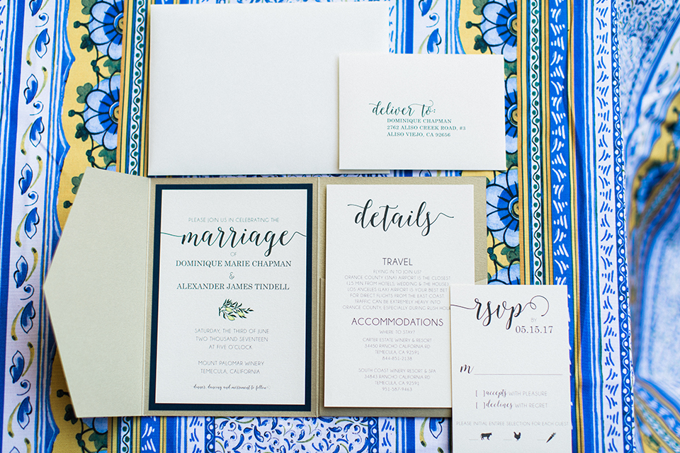 Temecula outdoor wedding at mount palomar winery white wedding invitations with black calligraphy writing and tan envelope with blue patterned linen background wedding photo idea for invitations