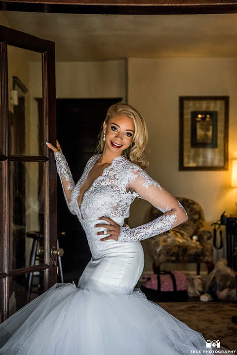 San diego outdoor wedding at mt woodson castle bride form fitting mermaid style gown with long lace sleeves and plunging neckline