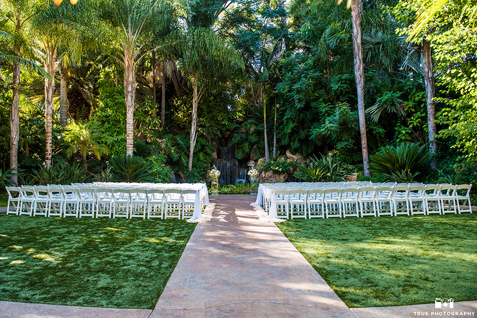 San diego outdoor wedding at the grand tradition estate ceremony set up on grass with white chairs and flower decor outdoor venue wedding photo idea for ceremony set up