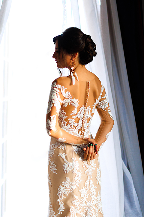 Orange county wedding shoot at jazz kitchen downtown disney bride form fitting lace gown with long illusion sleeves and sweetheart neckline with an open back design crossing arms